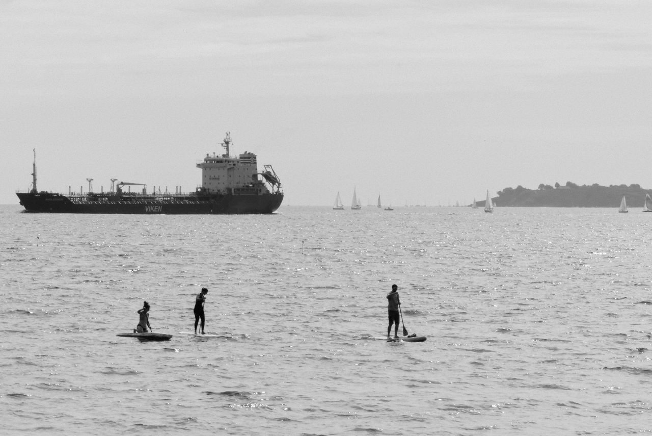 Bretagne Noir Et Blanc Beauty In Nature Blackandwhite Bw Day Leisure Activity Men Morbihan Nature Nautical Vessel Outdoors Paddle Paddleboarding People Real People Sea Sky Two People Water Waterfront Wave
