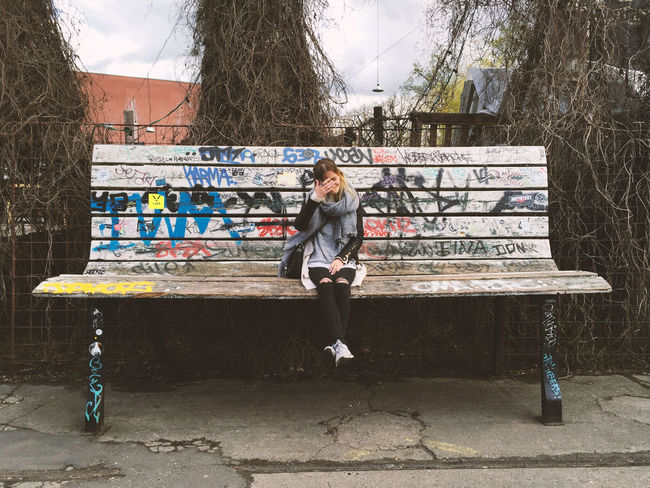 Girl on a huge bench in Berlin Benches Berlin Blonde Girl Casual Clothing Day Full Length Graffiti Greyish Leisure Activity Lifestyles Outdoors Oversized Peoplephotography Portrait Selfportrait Sky Smile Snapshot White Trash Fastfood