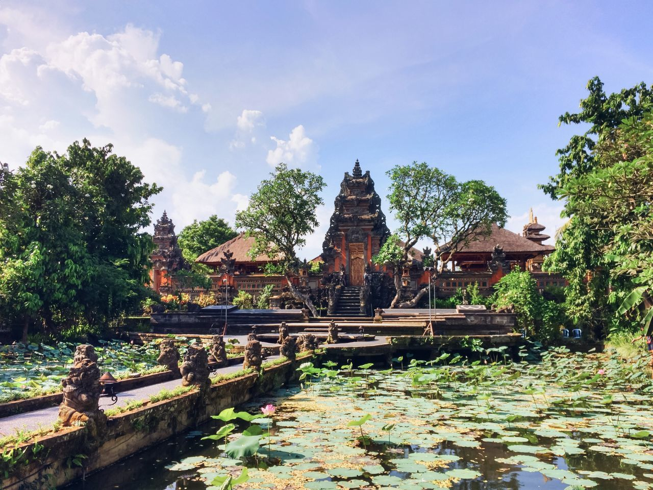 Bali Built Structure Cloud Cloud - Sky Day Growth Hindu Temple Hinduism Idyllic Lotus Nature No People Non-urban Scene Outdoors Plant Pond Scenics Sky Temple Temple - Building The Way Forward Tranquil Scene Tranquility Travel Destinations Water