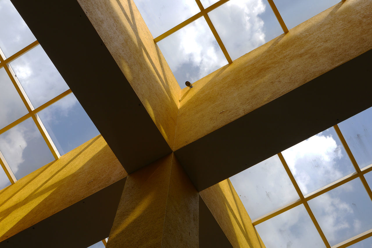 Architectural Feature Architecture Built Structure Ceiling Connection Lights And Shadows Low Angle View Modern Structure Yellow Centered Flowers