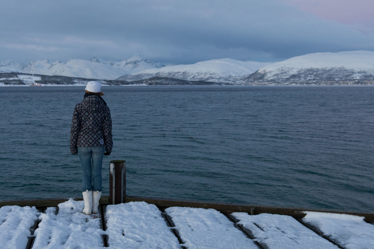 Arctic City Cold Cold Temperature Fjord Frozen Idyllic In Thought Jetty Norway Outdoors Pensive Pier Quay Scenics Snow Snow Covered Snowcapped Mountain Tranquil Scene Troms Tromsø Water Winter Winter Woman