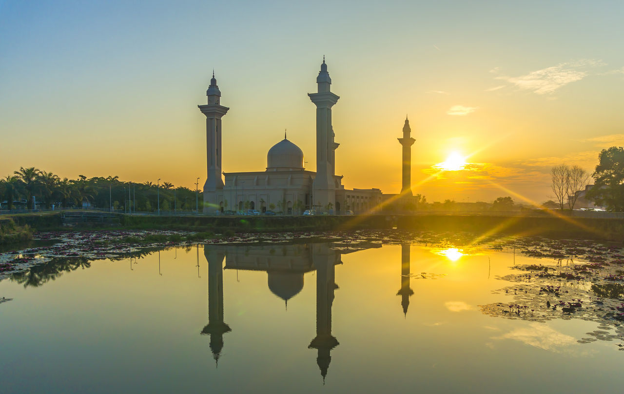 reflection, sunset, architecture, dome, built structure, water, building exterior, religion, travel destinations, sun, sky, tourism, spirituality, history, place of worship, outdoors, no people, day