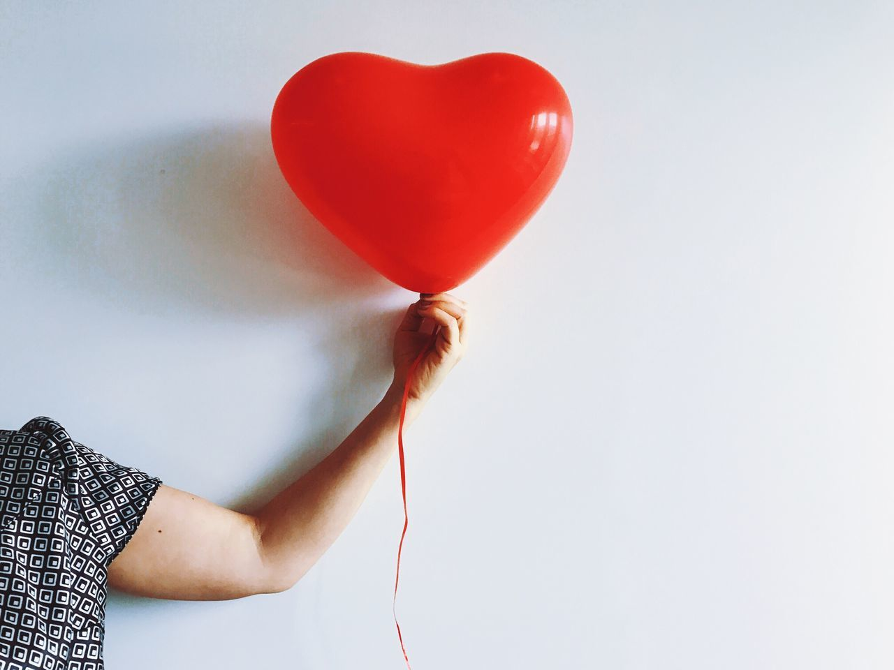 One Person Red Heart Shape Human Hand Balloon Human Body Part Holding Real People Love Helium Balloon Women Indoors  Close-up Low Section Day People