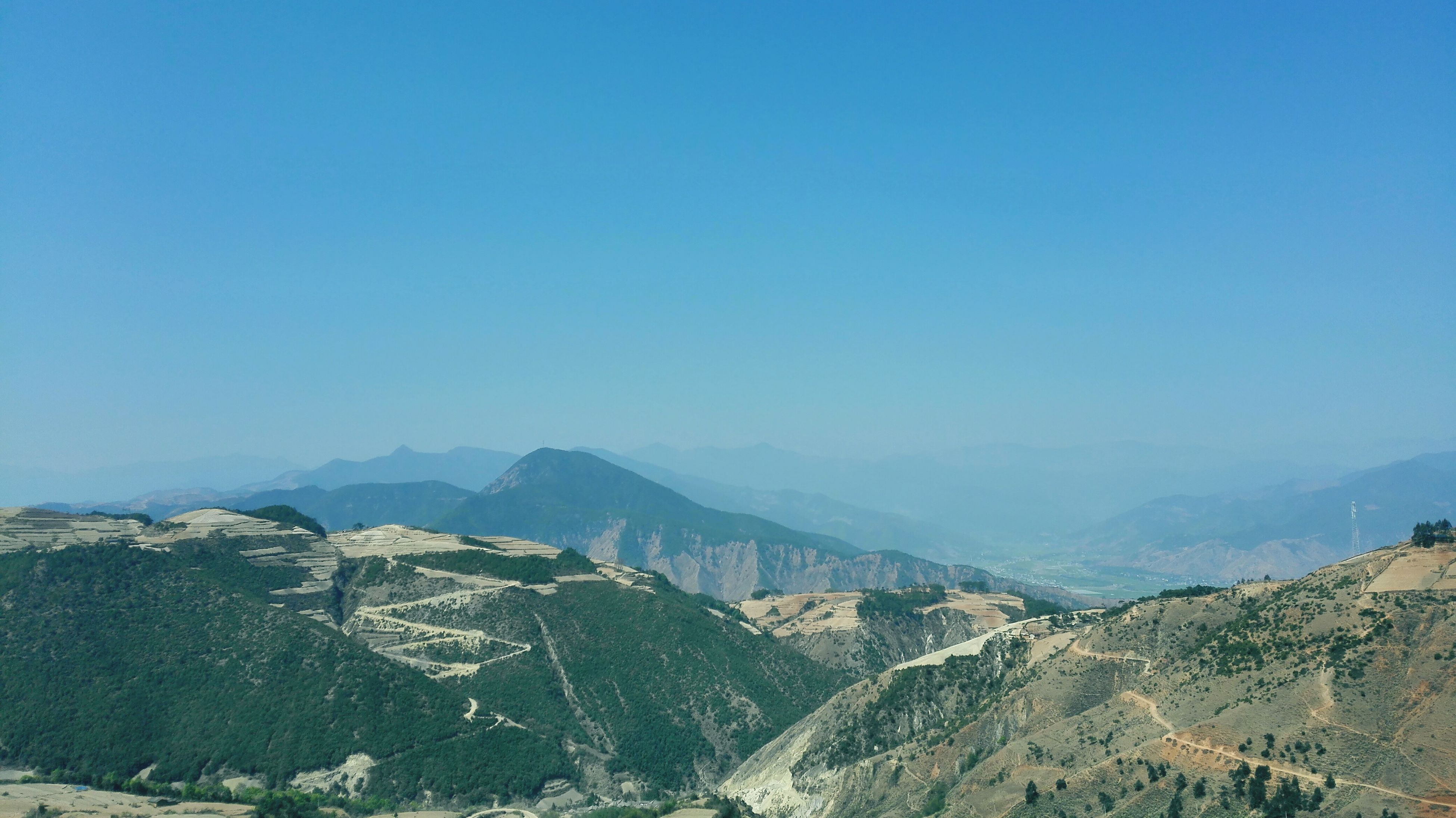 mountain, clear sky, copy space, tranquil scene, scenics, tranquility, blue, mountain range, landscape, beauty in nature, nature, non-urban scene, idyllic, remote, day, outdoors, no people, high angle view, sky, physical geography