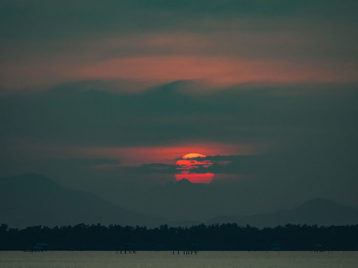 Beauty In Nature Cloud - Sky Day Landscape Mountain Nature No People Orange Color Outdoors Scenics Silhouette Sky Sunset Tranquil Scene Tranquility Tree Water