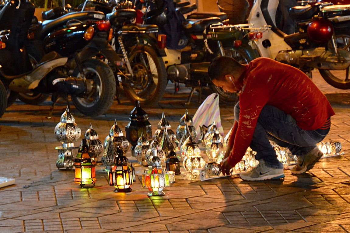 Traveling Travel Marrakech Marrakech La Medina De Marrakech Jemaa El Fnaa Nightphotography Night Lights Night Photography Nightlife Night Night View Light Lantern salesman light their lanterns in the square Jemaa el Fnaa, in the old Medinan in Marrakech