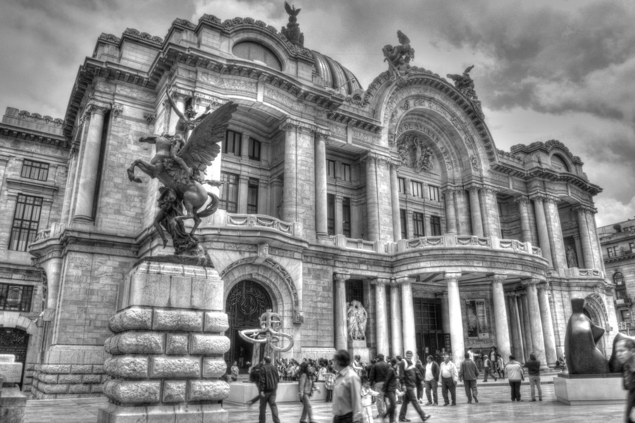 The Palace of Fine Arts, located in the Historic Center of Mexico City, is the highest seat of the expression of culture, the most important opera house and the most important in the country dedicated to all forms of the arts center. Unesco declared artistic monument in 1987. Architecture Bellas Artes, México D.F. Architecture Building Exterior Built Structure Day Façade History Low Angle View Outdoors Place Of Worship Real People Religion Sculpture Sky Spirituality Statue Travel Travel Destinations The Street Photographer - 2017 EyeEm Awards EyeEmNewHere