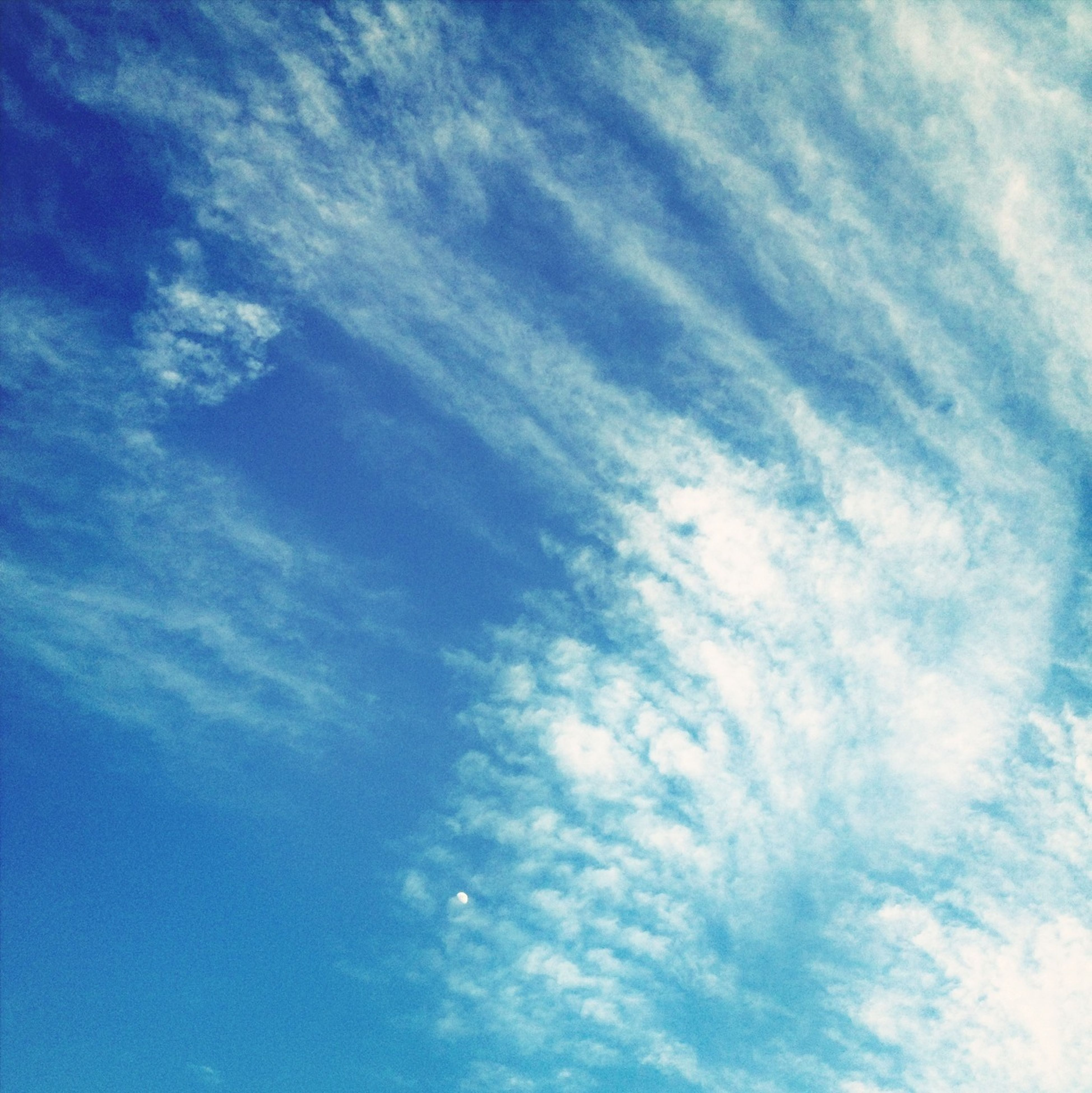 low angle view, sky, blue, cloud - sky, beauty in nature, sky only, tranquility, scenics, nature, cloudy, backgrounds, cloud, tranquil scene, full frame, cloudscape, idyllic, outdoors, day, no people, white color