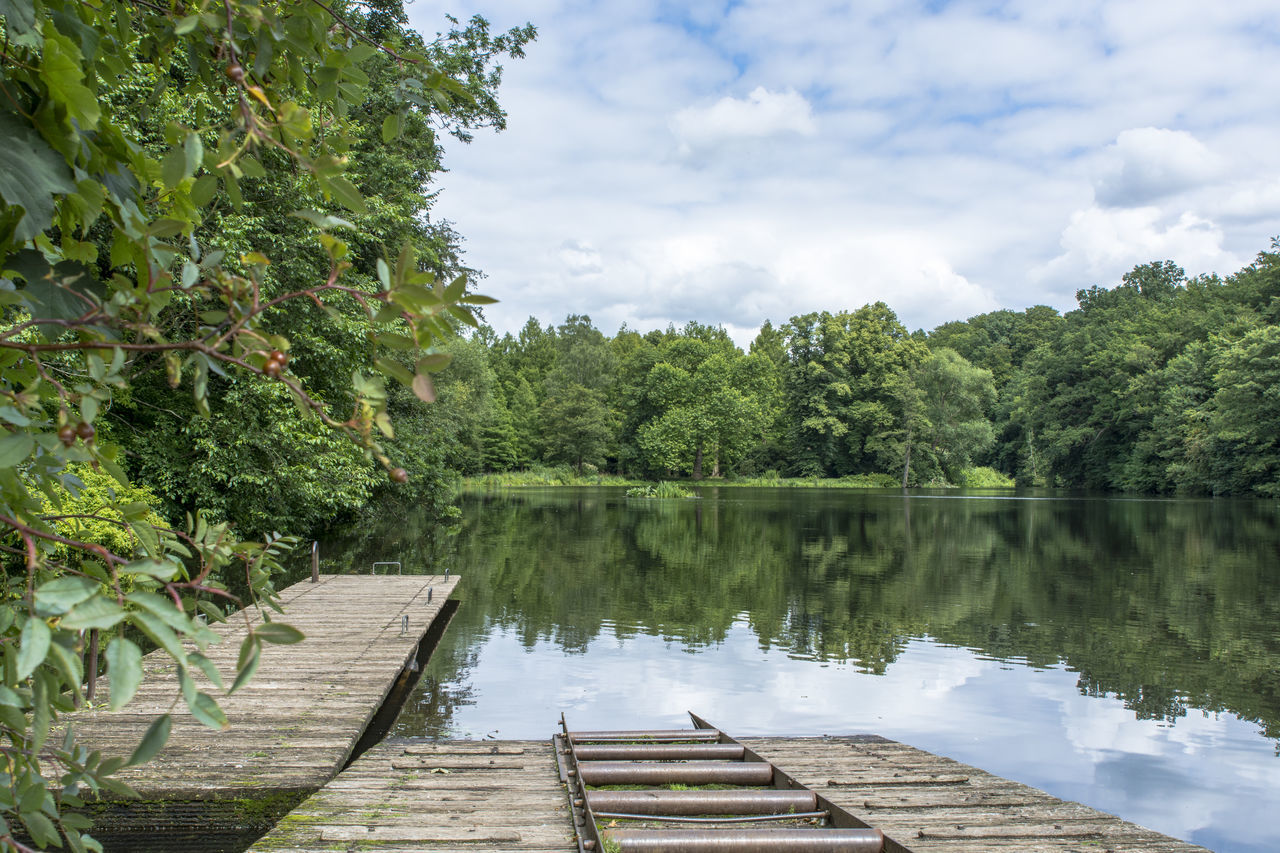 Boat Dock Clouds Horizontal Symmetry Lake Lakeshore Reflection Relaxing Moments Standing Water Tranquil Scene
