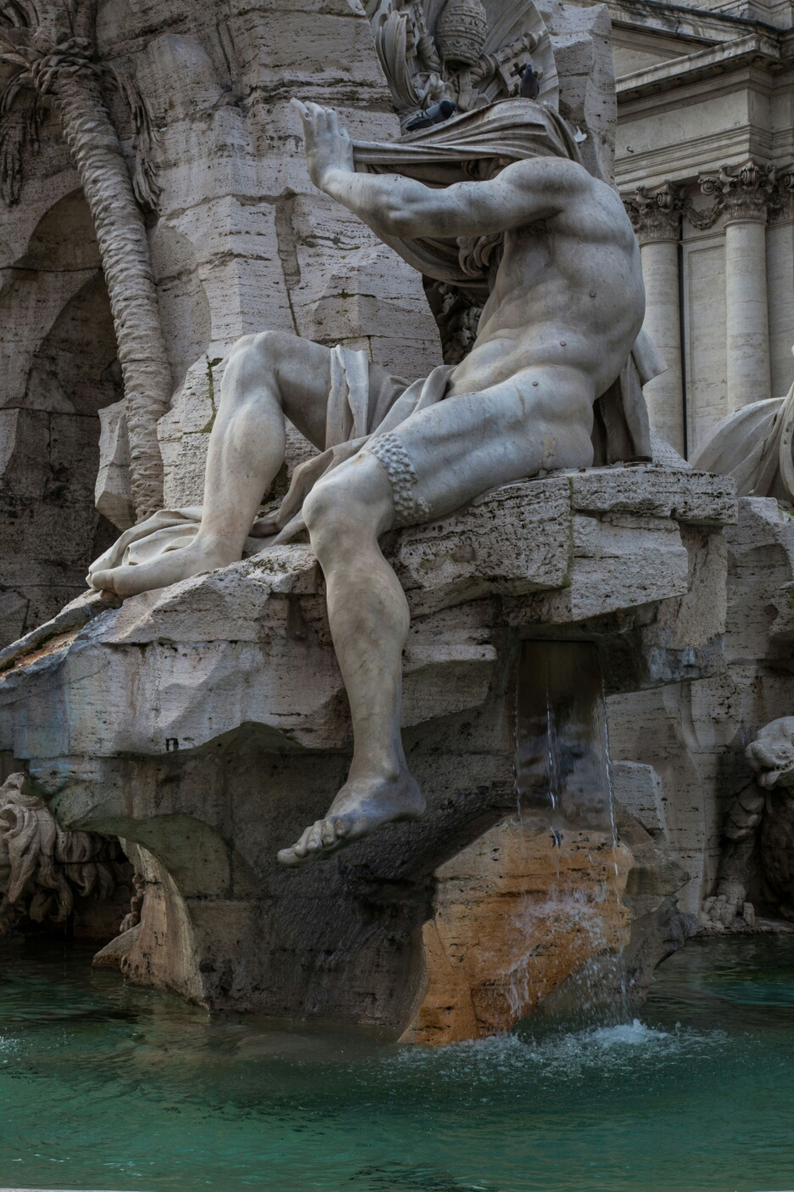 water, statue, sculpture, human representation, art and craft, built structure, architecture, art, waterfront, creativity, building exterior, day, history, outdoors, animal representation, fountain, carving - craft product, no people