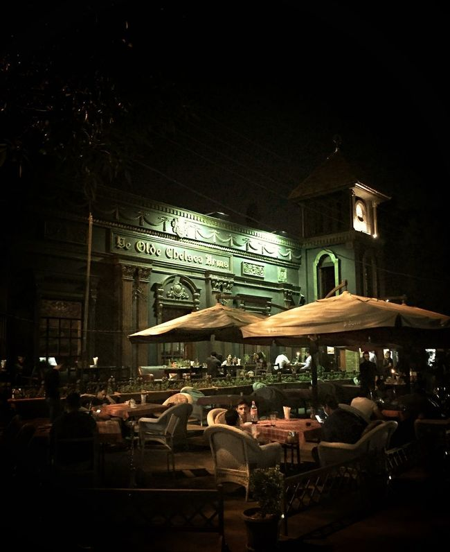 """""""Ye Olde Chelsea Arms"""" Did not expect to come across this on our first night in Tashkent Uzbekistan Uzbekistan Central Asia Chair Cities At Night Dark Drinks With Friends Electric Lamp Empty Hotel Illuminated Lifestyles Night Restaurant Uzbekistan • The Street Photographer – 2016 EyeEm Awards"""