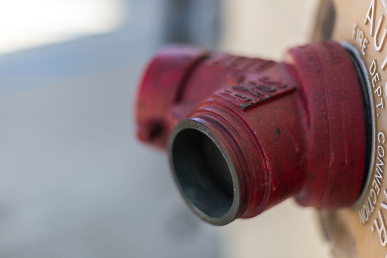 fire hydrant Building Exterior Close-up Day Emergency Equipment Fire Hydrant Focus On Foreground Metal Pipe No People Outdoors Red Red Color Shade Shaded Shallow Depth Of Field