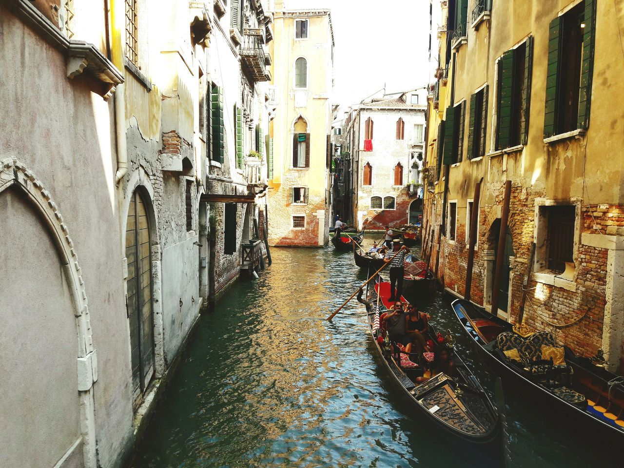 architecture, building exterior, canal, built structure, nautical vessel, water, window, residential building, day, gondola - traditional boat, transportation, outdoors, no people, city