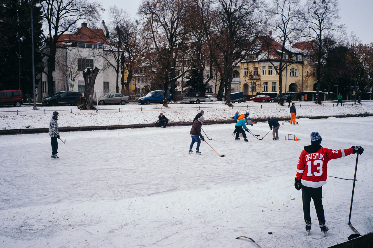 Winter Adult Architecture Built Structure Child Childhood Cold Temperature Day Hockey Ice Hockey Ice Rink Icehockey Minga Outdoors People Real People Snow Taking A Shot - Sport Tree Warm Clothing Winter Winter Sport