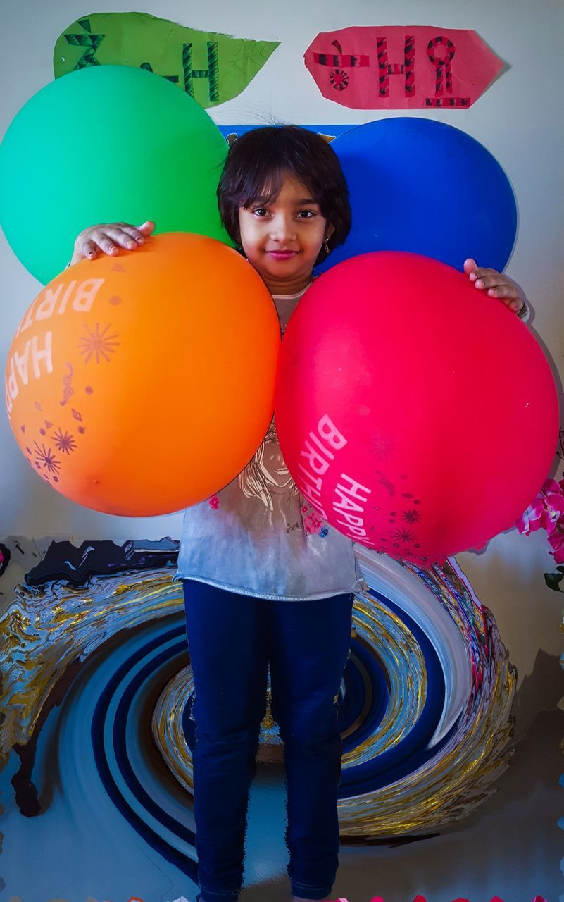 balloon, childhood, one person, real people, looking at camera, boys, playing, portrait, multi colored, blue, full length, indoors, day