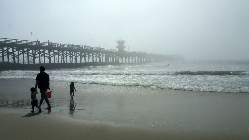 The Purist (no Edit, No Filter) Father And Children Family At The Beach Holding Hands Keeping Safe White Space Foggy Day Fog At Beach Ocean Playing At The Beach Love calm Serene Outdoors seal beach Showcase: February Seal Beach California Surf's Up