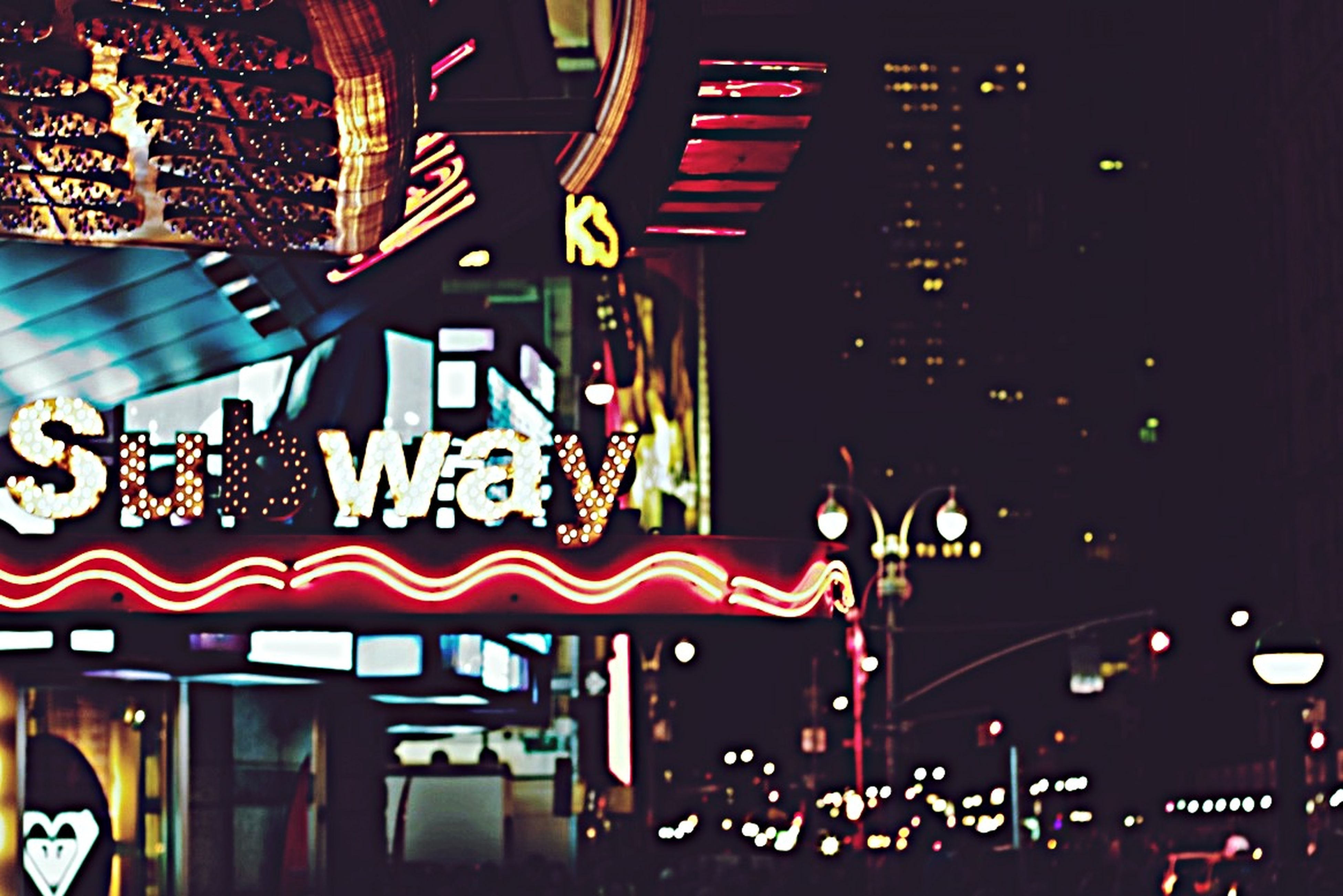 illuminated, night, built structure, architecture, building exterior, text, lighting equipment, indoors, multi colored, city, no people, communication, western script, graffiti, building, arts culture and entertainment, low angle view, non-western script, red