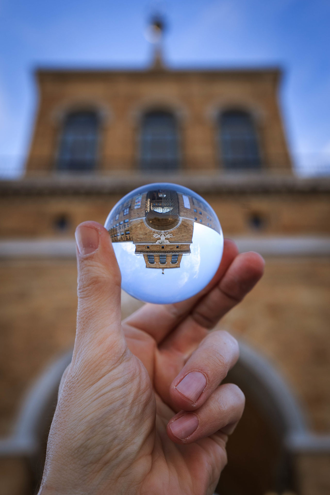 Human Hand Human Body Part Holding Personal Perspective One Person Travel Destinations Building Exterior Architecture Close-up Day Canon 6D Tamron Gijón Asturias España SPAIN Esfera Sphere Focus On Foreground Built Structure People One Man Only Adult Outdoors
