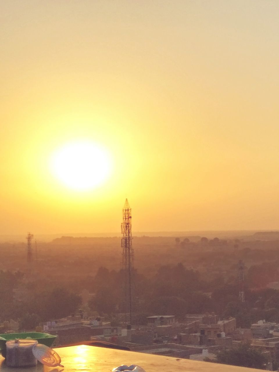 sun, sunset, orange color, electricity pylon, sunlight, built structure, no people, scenics, nature, outdoors, sky, beauty in nature, architecture, building exterior, clear sky, city, day