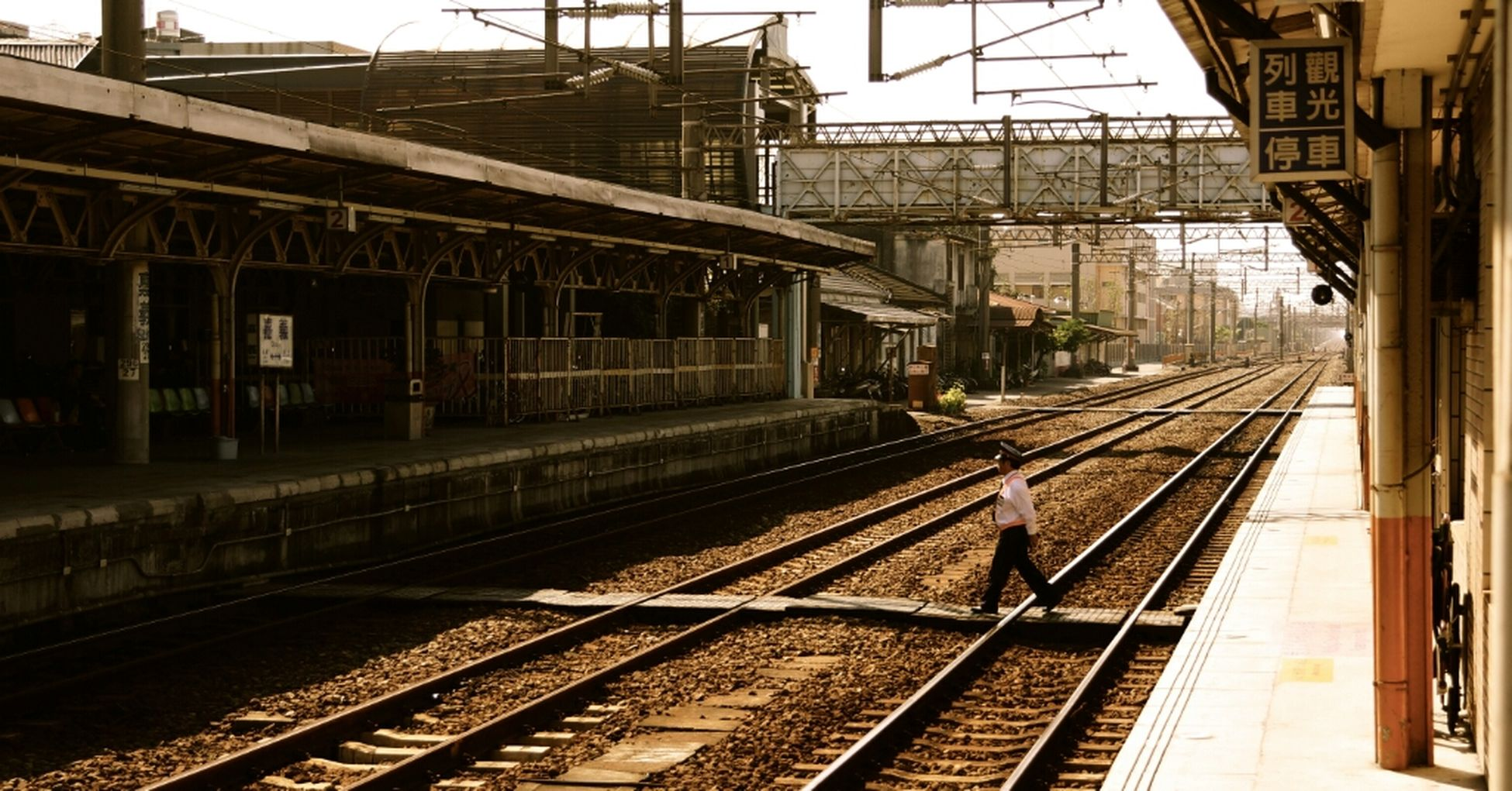 railroad track, rail transportation, railroad station platform, public transportation, railroad station, transportation, built structure, architecture, building exterior, train - vehicle, railway track, city, train, travel, passenger train, railway station, public transport, the way forward, diminishing perspective, sky