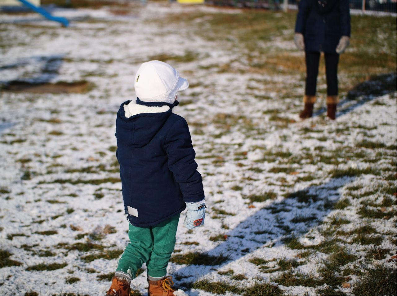 Decisions... Rear View Winter Warm Clothing Childhood Snow Cap Standing Real People Cold Temperature Nature City Life Winter Coat Winter In The City Leisure Activity Fresh On Eyeem  Made In Romania My Favorite Photo Found On The Roll Details Of My Life Fun Mother And Son Vscocam Playground Child Snow Covered