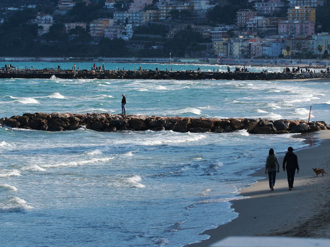 the sea in Winter Background Beach Italy Laigueglia Lifestyles Liguria - Riviera Di Ponente Liguria,Italy People Person Piers Real People Sea Silhouette Walking Water Wave