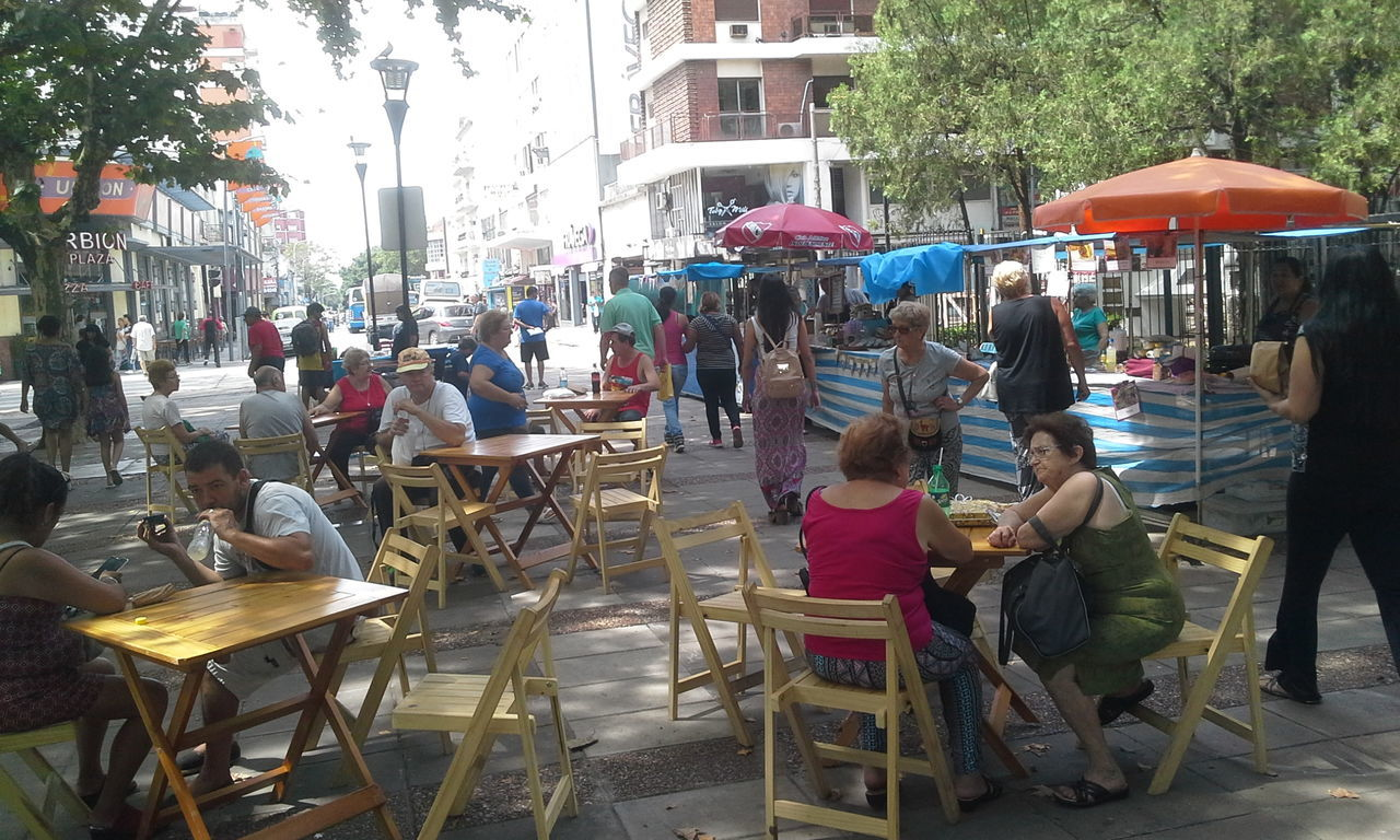large group of people, chair, real people, sitting, men, women, outdoors, day, food, city, people, adult