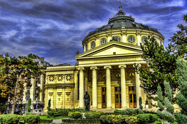 Image with Romanian Athenaeum Architectural Column Architecture Art Athenaeum Athenaeum Centre Atheneum Building Building Exterior Built Structure City Cloud - Sky Day Government Government Building Lanmark No People Outdoors Sky Travel Travel Destinations Tree