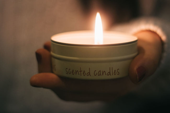 Candle Canon Showcase: February Canonphotography Lifestyles Holding Hand Candles Scented Scented Candle EyeEm Front View Flame Learn & Shoot: Simplicity Learn & Shoot: After Dark Learn & Shoot: Single Light Source Burning Candlelight Fire Fire - Natural Phenomenon Lit Decoration Mystery Hands Scented Candles