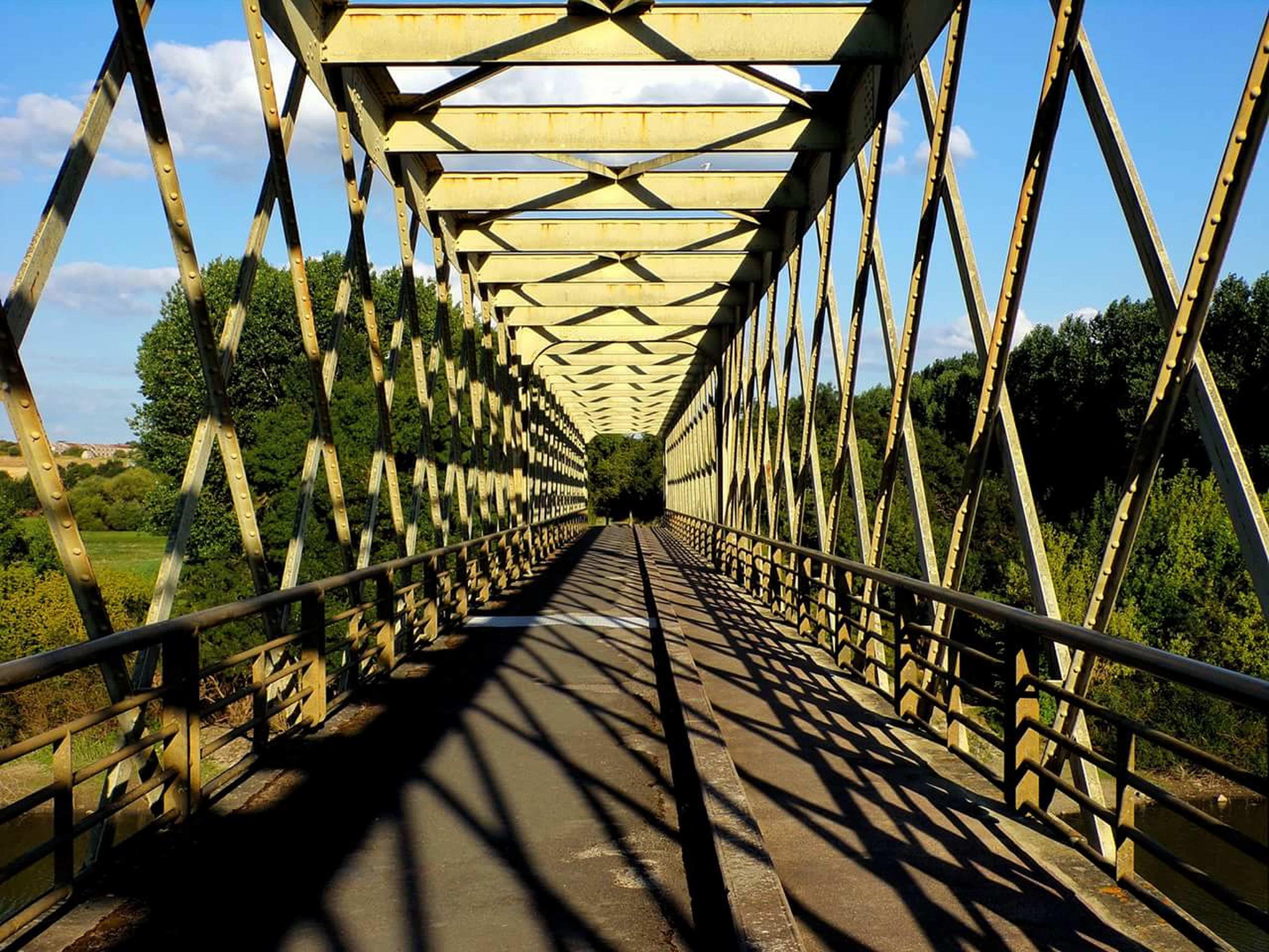 shadow, sunlight, sky, metal, bridge - man made structure, day, outdoors, tree, no people, built structure, connection, nature, architecture