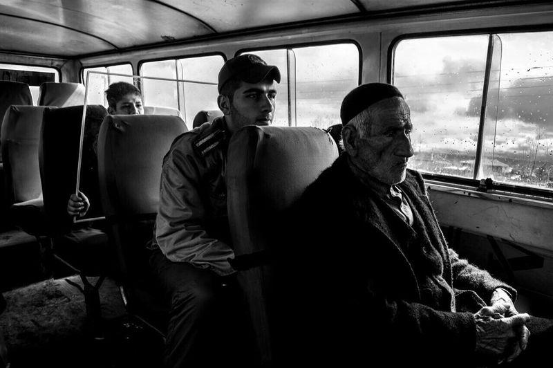 Showcase April Black & White My Commute Iranian People Alipix Iran Worldpressphoto Everyday People The Week Of Eyeem 1395 Oldman Child Soldier Minibus Masouleh ©Ali Nazariatjoo The Photojournalist - 2016 EyeEm Awards