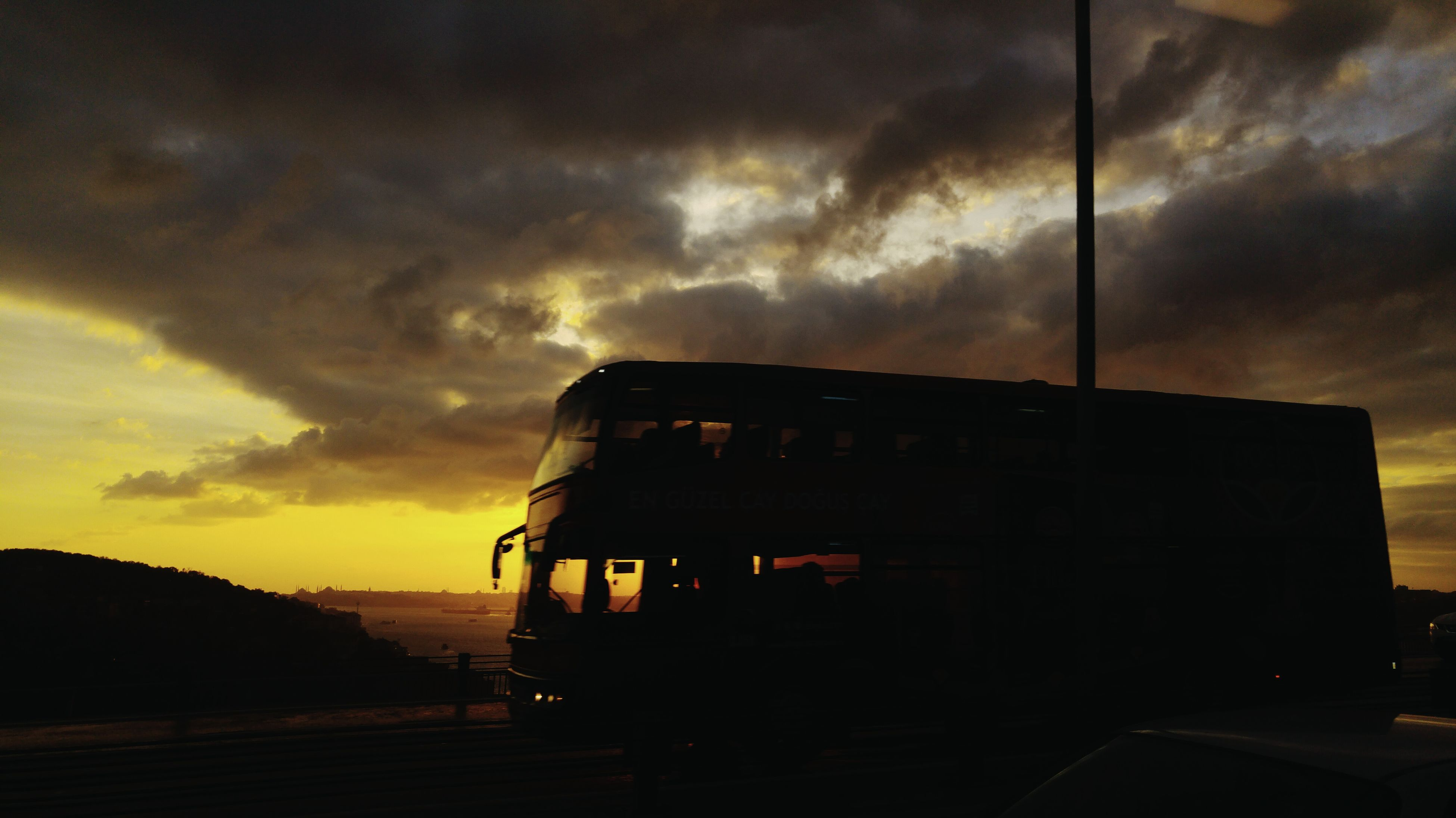 sky, cloud - sky, sunset, transportation, mode of transport, dramatic sky, outdoors, no people, nature, beauty in nature, night