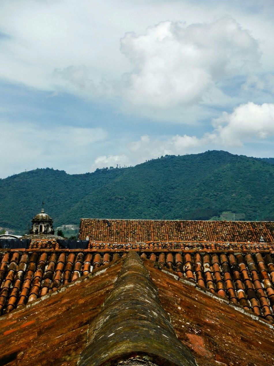 On the rooft tops Antigua Guatemala AntiguaGuatemala Antigua, Guatemala Antigua Guatemala Guatemala View Roof Top Roof Tops Rooftop Rooftops Roof Roof Tile Rooftop View  Leading Lines Red Tiles Red Tile Red Tile Roofs Old Buildings Spanish Architecture Colonial Colonial Architecture Colonial Style On The Roof Outdoors Cloud - Sky