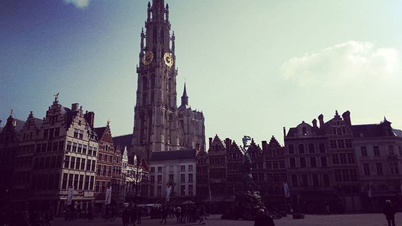 The picturesque Grote Mark of Antwerp with the Onze-Lieve-Vrouwekathedral in the background Grotemarktantwerpen Onzelievevrouwekathedraal Antwerp Belgium