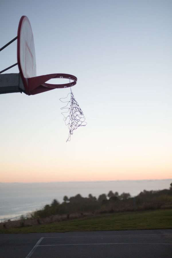 Hoop at twilight Basketball Basketball Court Getting Dark Hillside Hoop Net Ocean View Orange Glow In The Sky Outdoors Pink Glow In The Sky Shallow Depth Of Field Sky Twilight