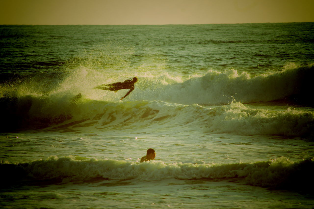 Man Surfing On Sea