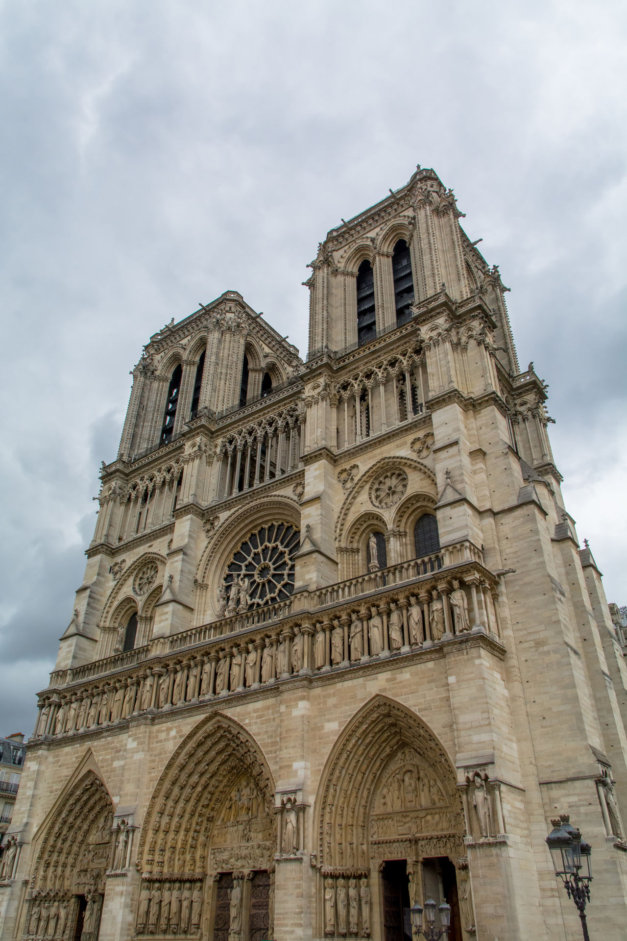 Architecture Archs Building Exterior Built Structure Cathedral Cloud - Sky Clouds Day Famous Place Façade Gothic History Low Angle View Low Angle View No People Notre Dame De Paris Outdoors Paris Place Of Worship Religion Sky Spirituality Towers Travel Destinations