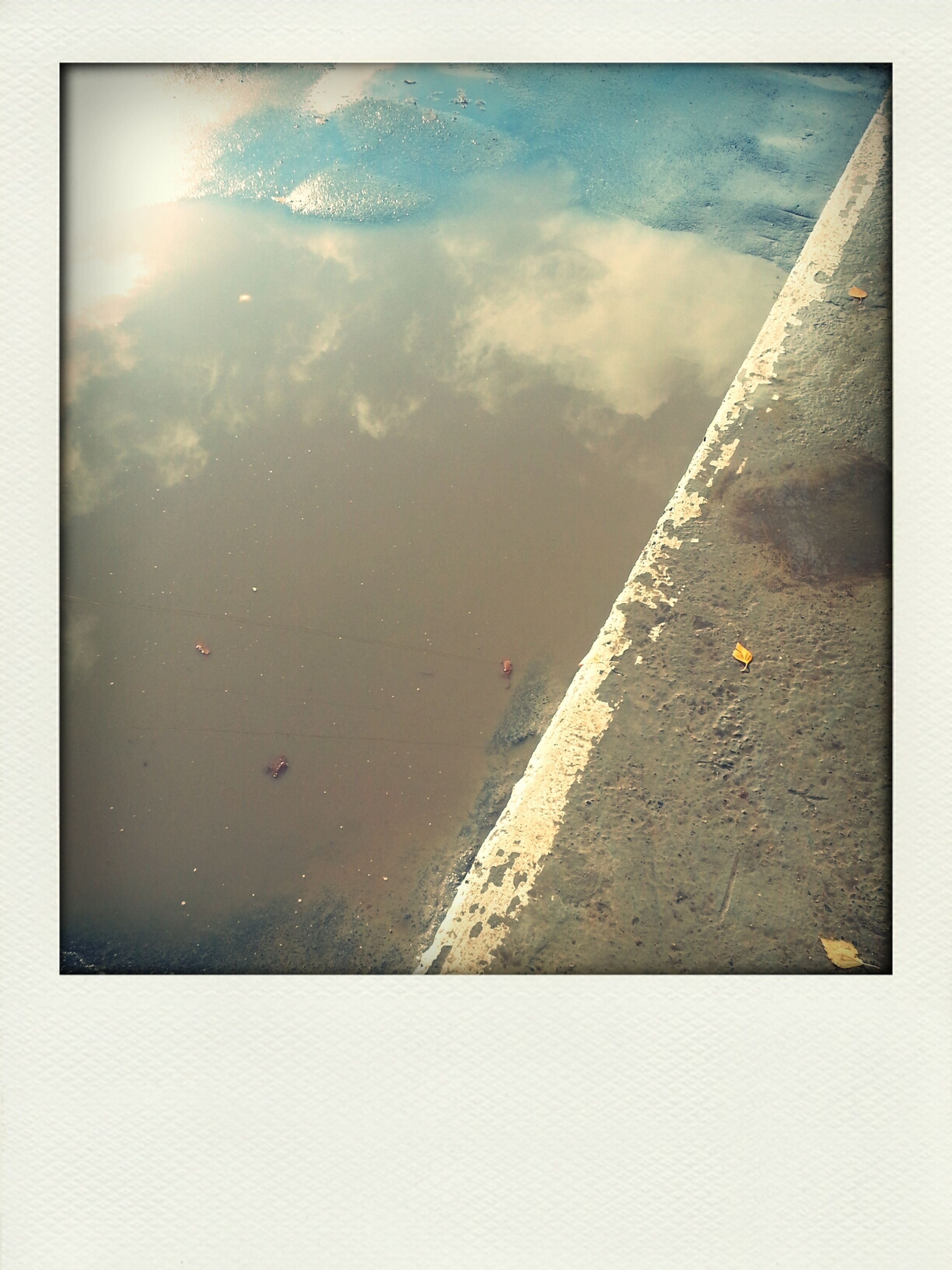 transfer print, water, auto post production filter, sky, high angle view, cloud - sky, sea, day, built structure, outdoors, reflection, puddle, architecture, no people, nature, wet, transportation, waterfront, cloud, tranquility