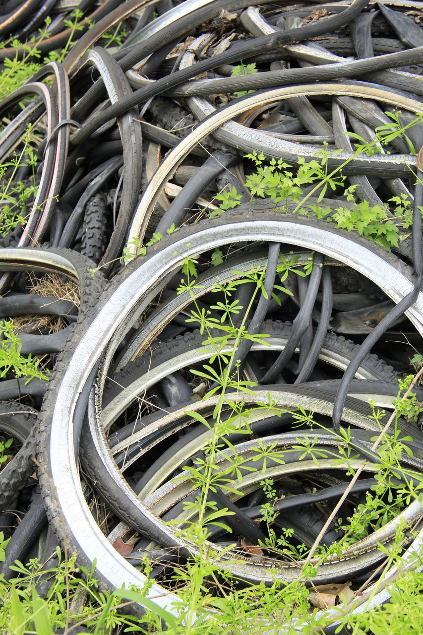 large group of objects, outdoors, day, no people, close-up, bicycle rack, tire