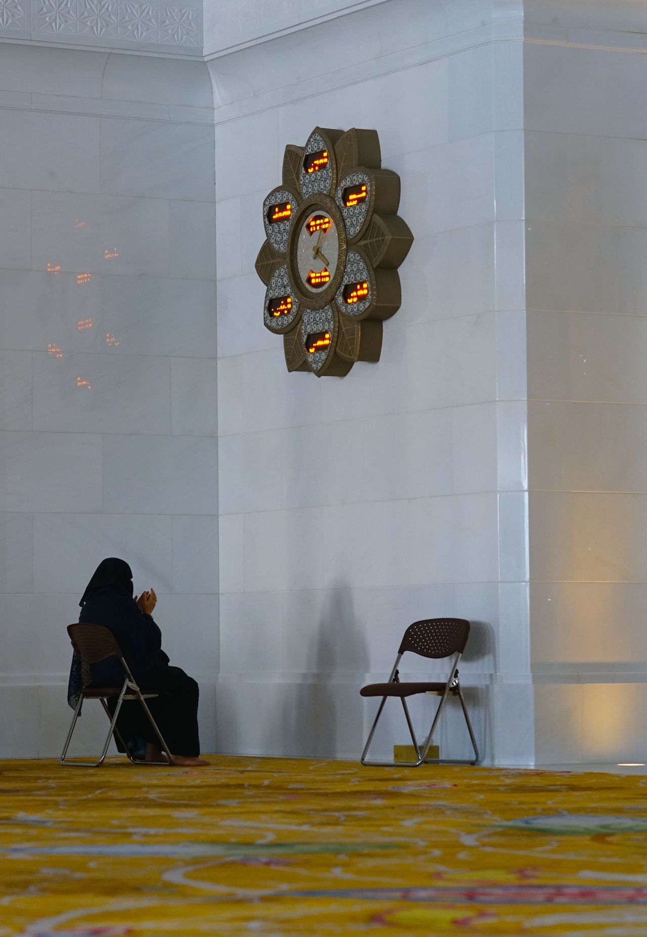 Abu Dhabi Abu Dhabi Grand Mosque Adults Only Chair Clock Indoors  Islam Mosque Munajat Muslim Culture Muslim Woman Muslim Woman Praying Non Recognizable Female One Person Prayer Prayer Time Praying Sheikh Zayed Grand Mosque Women Around The World Women Around The World Women Around The World