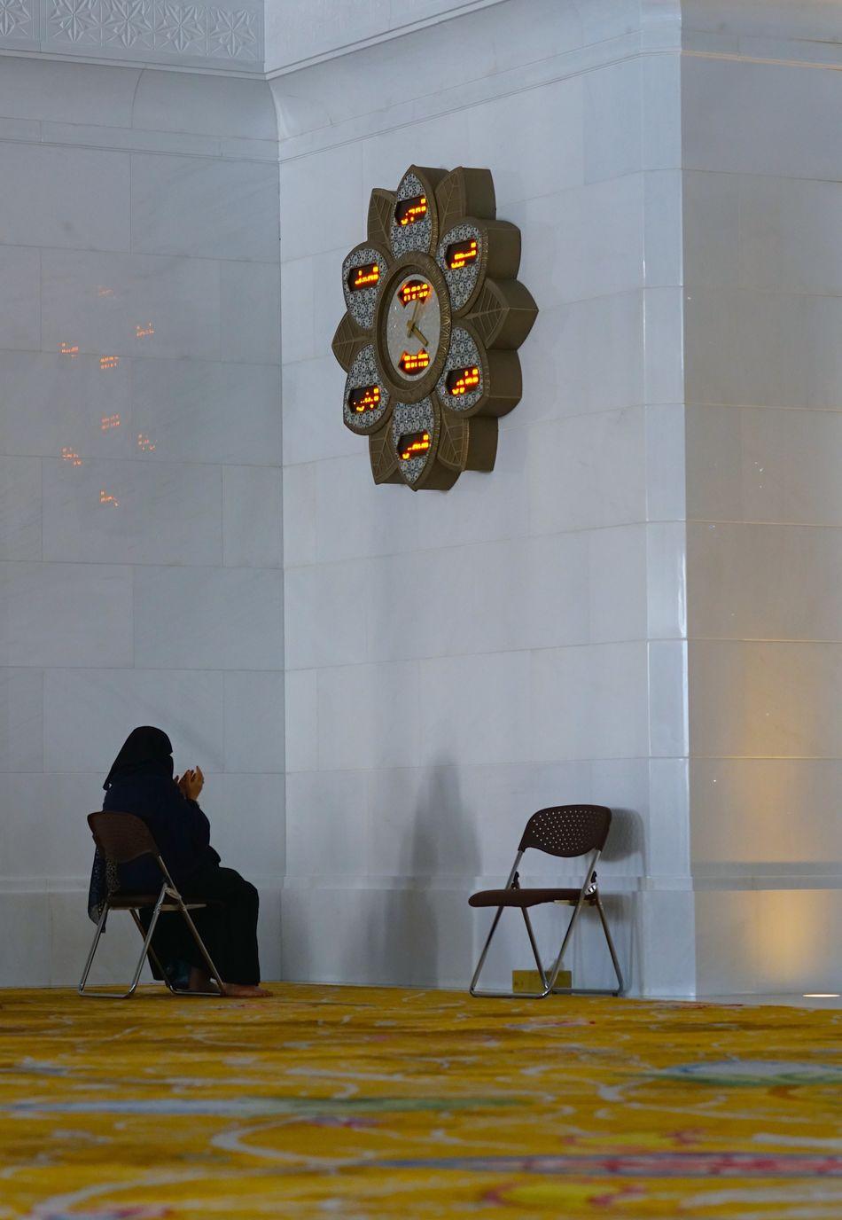 Abu Dhabi Abu Dhabi Grand Mosque Adults Only Chair Clock Indoors  Islam Mosque Munajat Muslim Culture Muslim Woman Muslim Woman Praying Non Recognizable Female One Person Prayer Prayer Time Praying Sheikh Zayed Grand Mosque Women Around The World Women Around The World Women Around The World