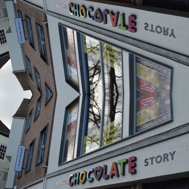 Chocolate facade Architecture Reflection Eye For Photography EyeEm Gallery The Week On EyeEm Mix Yourself A Good Time Artofvisuals Chocolate♡ Storefront Storefront Display Eyeem Market From My Point Of View Window Built Structure Modern Store Windows Architecture Store Sign Storefronts