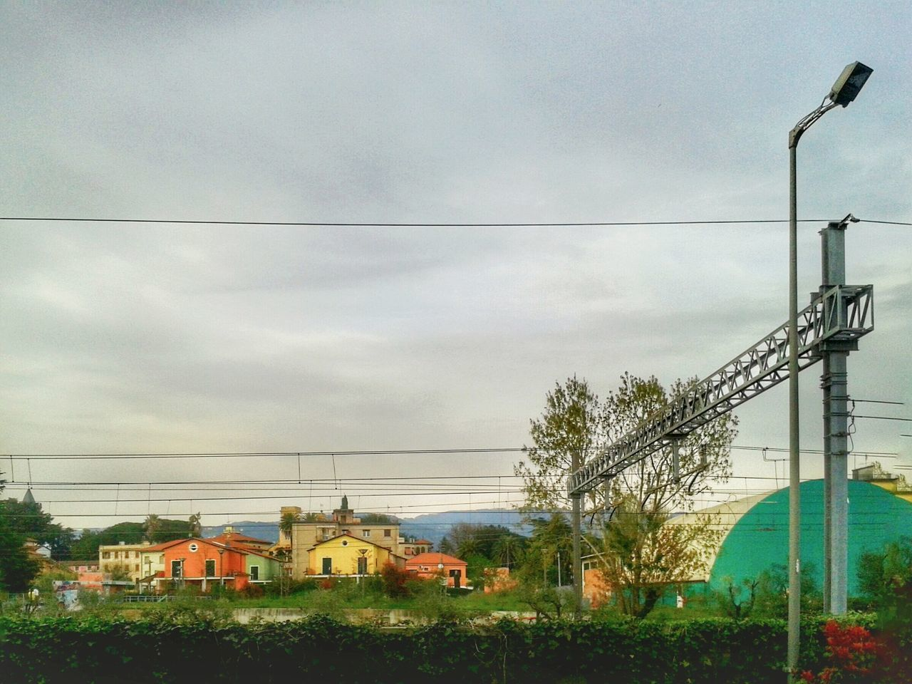 """""""Colourful houses"""", and greenhouse, in Sarzana, Italy. From My Window Railway Houses Landscape Peaceful in spite of the tracks Mobile Photography with S3mini and Camerazoomfx in HDR shooting mode ( Multiple Exposure)"""