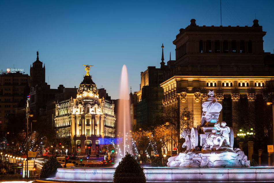 Alcala and Cibeles fountain in Madrid at dusk Alcalá Architecture Arrival Built Structure Christmas Christmas Decoration Christmas Lights Cibeles City Cityscape Cityscape Dusk Illuminated Market Metropolis Night Outdoors People Statue Sunset Tourism Travel Tree