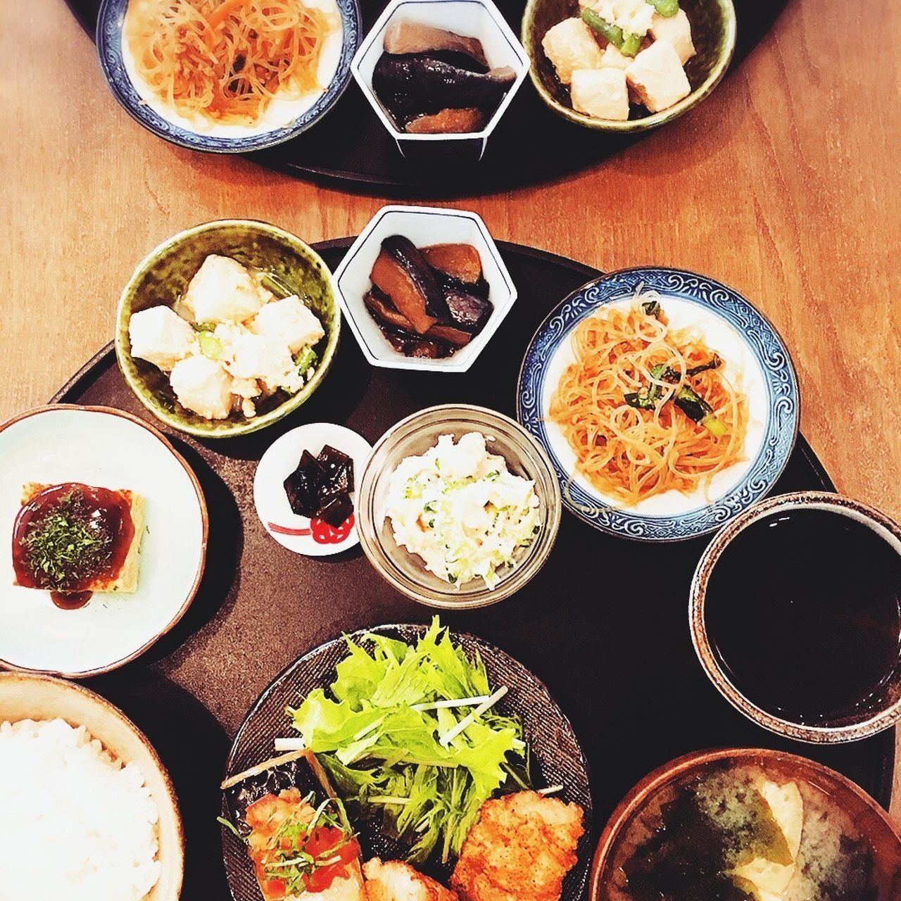food and drink, table, food, plate, ready-to-eat, bowl, variation, indoors, healthy eating, serving size, high angle view, freshness, salad, no people, spring roll, day