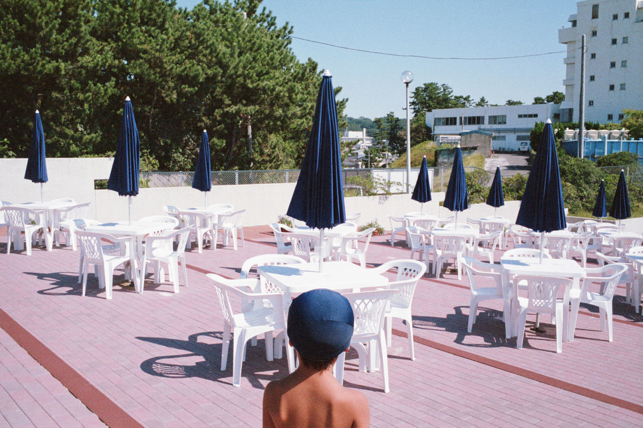 Boy Near A Restaurant