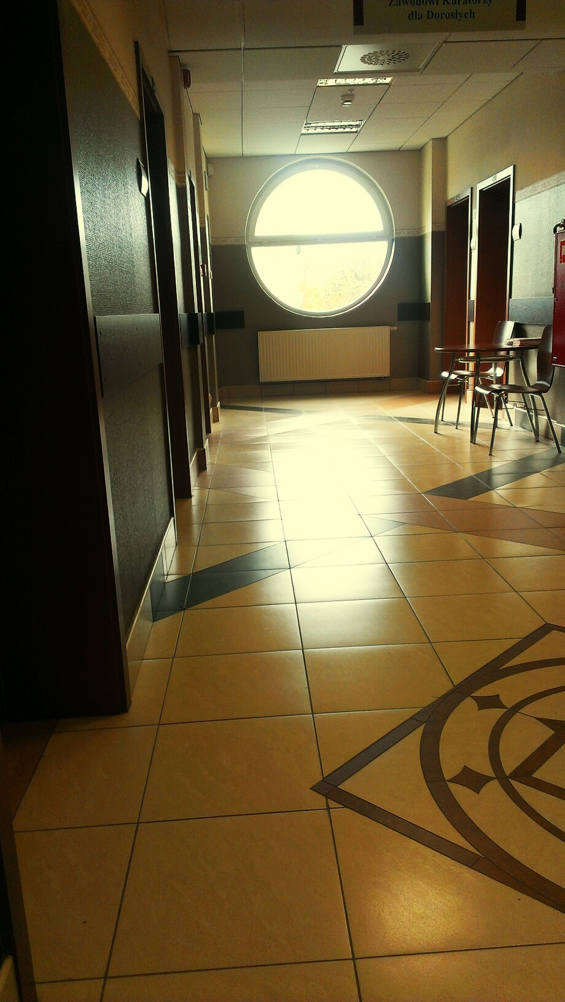 indoors, flooring, tiled floor, empty, architecture, built structure, absence, corridor, ceiling, floor, the way forward, illuminated, sunlight, interior, tile, no people, shadow, diminishing perspective, chair, home interior