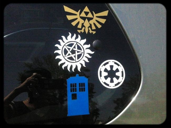 Added new decals to my car window.