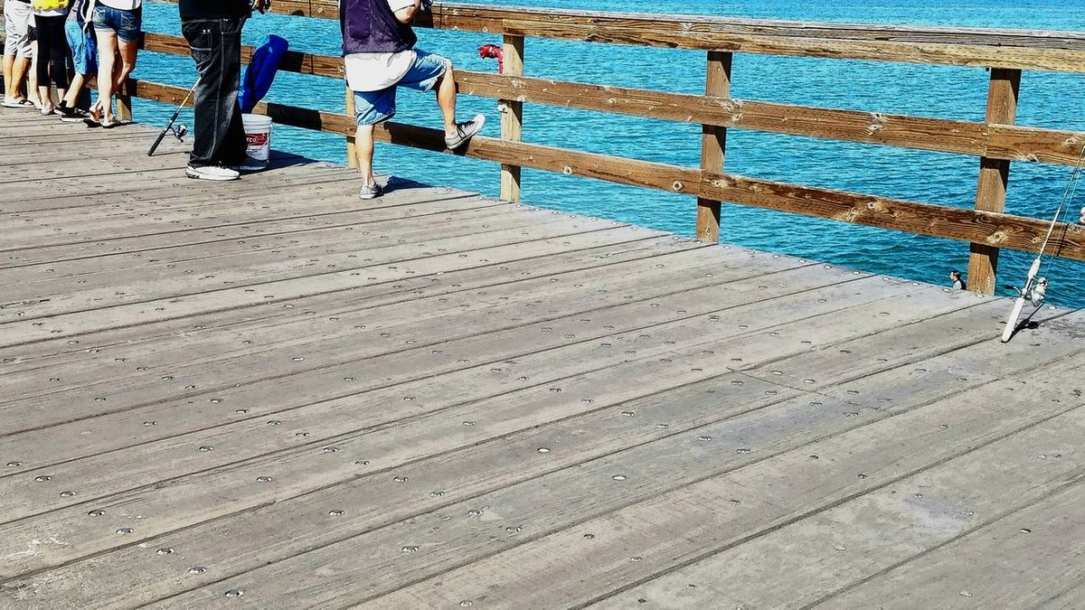 Graphic Lets Go. Together. Outdoors Beach Pattern Sunlight Pier Fishing Pier Relaxation Vacations Sport Copy Space Tranquil Scene Fishing Leisure Activity Sea Water Tranquility Background Meditation Scenics Day Breathing Space