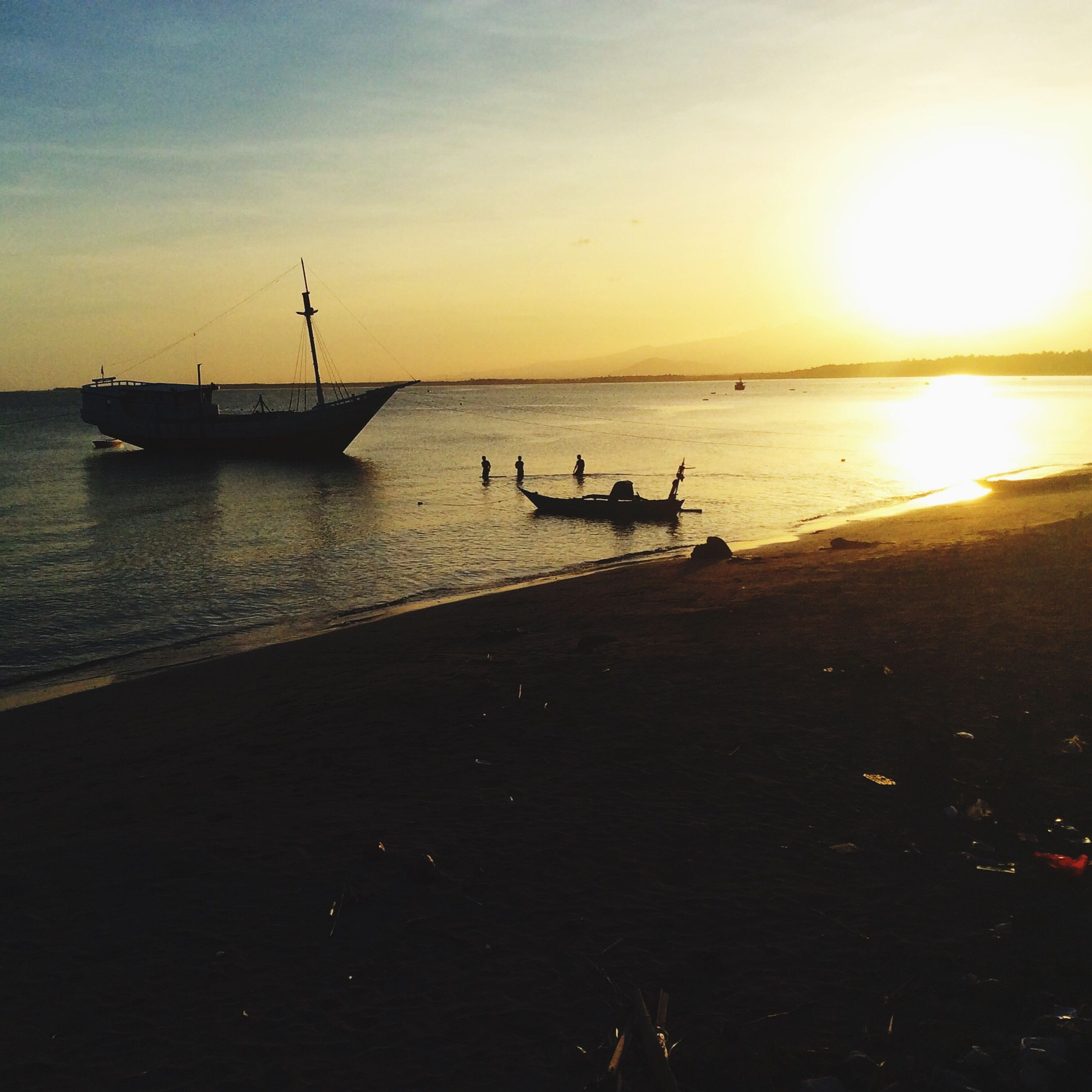 sunset, sea, nautical vessel, transportation, water, mode of transport, boat, sun, horizon over water, scenics, orange color, sky, silhouette, tranquil scene, beauty in nature, tranquility, moored, nature, beach, sunlight